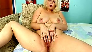 Blonde mom Zenova Braeden wanks in front of cam and then gives a hot blowjob